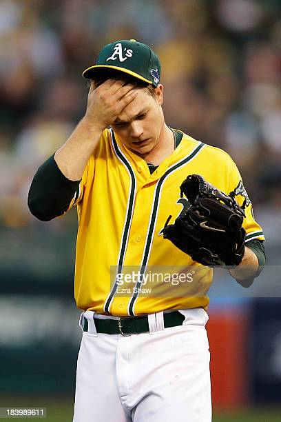 Sonny Gray of the Oakland Athletics reacts after giving up a single to Jhonny Peralta of the Detroit Tigers in the fourth inning during Game Five of...