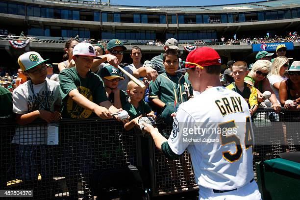 Sonny Gray of the Oakland Athletics signs autographs prior to the game against the Toronto Blue Jays at Oco Coliseum on July 4 2014 in Oakland...