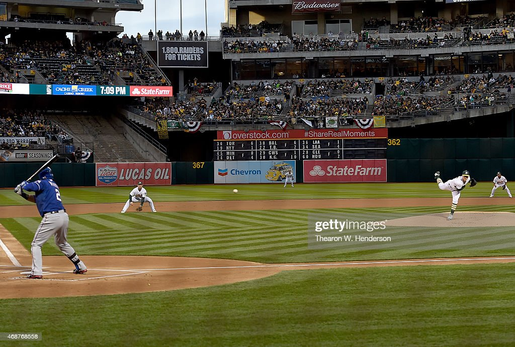<a gi-track='captionPersonalityLinkClicked' href=/galleries/search?phrase=Sonny+Gray&family=editorial&specificpeople=8046451 ng-click='$event.stopPropagation()'>Sonny Gray</a> #54 of the Oakland Athletics throws the first pitch of the game to Leonys Martin #2 of the Texas Rangers in the top of the first inning on Opening Day at O.co Coliseum on April 6, 2015 in Oakland, California.