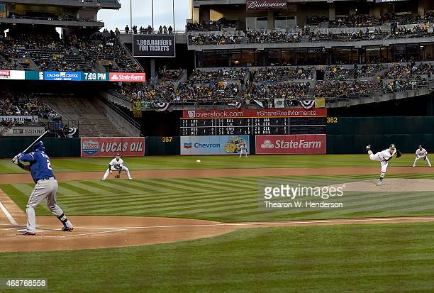 Sonny Gray of the Oakland Athletics throws the first pitch of the game to Leonys Martin of the Texas Rangers in the top of the first inning on...