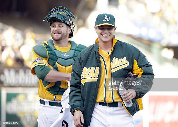 Sonny Gray of the Oakland Athletics walks in from the bullpen with catcher Stephen Vogt before their game against the Detroit Tigers at Oco Coliseum...