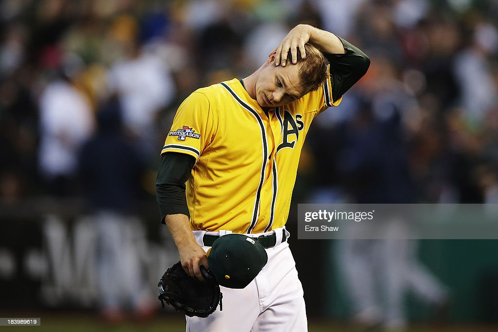 <a gi-track='captionPersonalityLinkClicked' href=/galleries/search?phrase=Sonny+Gray&family=editorial&specificpeople=8046451 ng-click='$event.stopPropagation()'>Sonny Gray</a> #54 of the Oakland Athletics walks off outfield the field in the fourth inning against the Detroit Tigers during Game Five of the American League Division Series at O.co Coliseum on October 10, 2013 in Oakland, California.