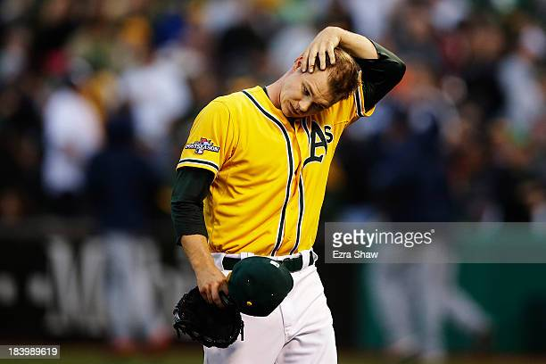 Sonny Gray of the Oakland Athletics walks off outfield the field in the fourth inning against the Detroit Tigers during Game Five of the American...