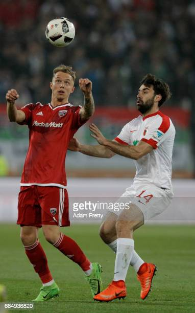 Sonny Kittel of Augsburg and Jan Movarek of Ingolstadt battle for the ball during the Bundesliga match between FC Augsburg and FC Ingolstadt 04 at...
