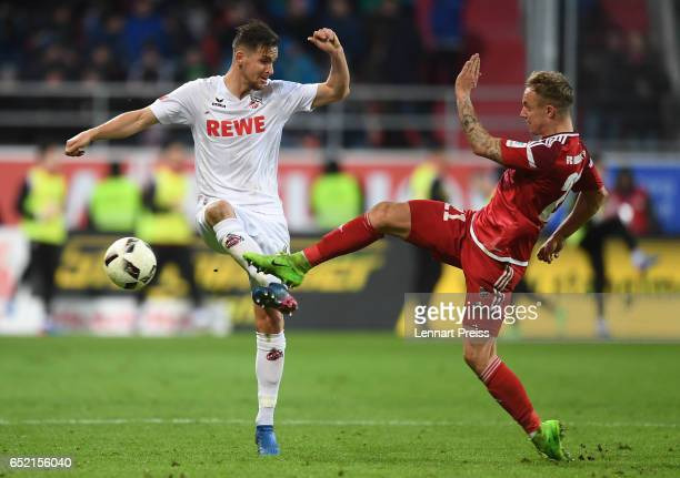 Sonny Kittel of FC Ingolstadt challenges Pawel Olkowski of 1 FC Koeln during the Bundesliga match between FC Ingolstadt 04 and 1 FC Koeln at Audi...