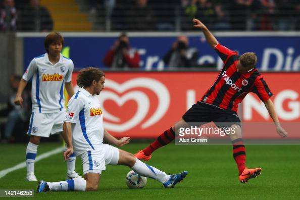 Sonny Kittel of Frankfurt is challenged by Faton Toski and Takashi Inui of Bochum during the Second Bundesliga match between Eintracht Frankfurt and...