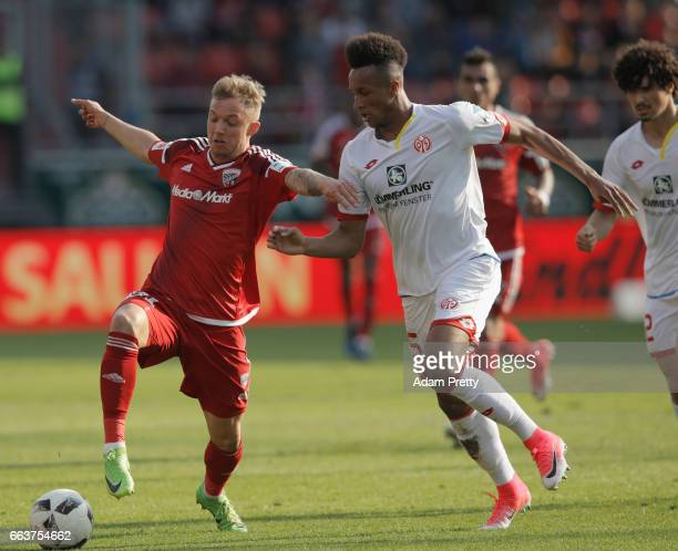Sonny Kittel of Ingolstadt is challenged by André Ramalho of Mainz during the Bundesliga match between FC Ingolstadt 04 and 1 FSV Mainz 05 at Audi...