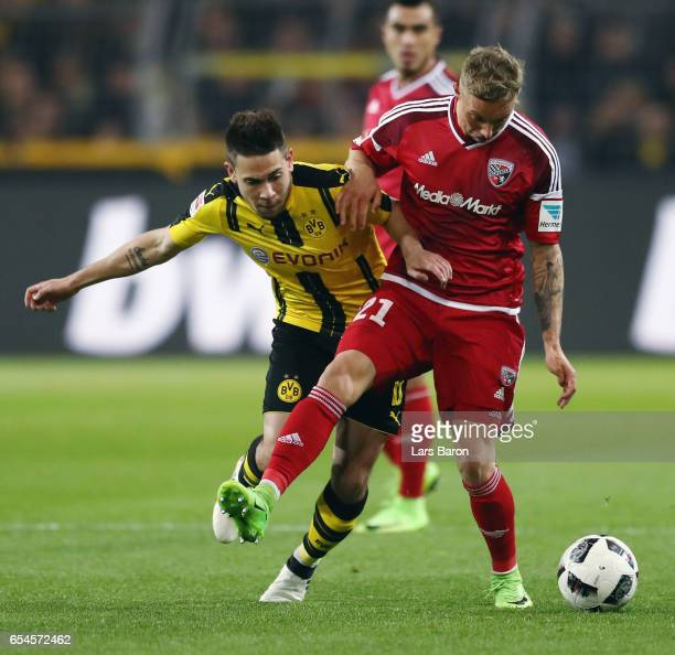 Sonny Kittel of Ingolstadt is challenged by Raphael Guerreiro of Dortmund during the Bundesliga match between Borussia Dortmund and FC Ingolstadt 04...