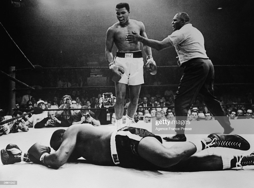 Sonny Liston lies out for the count after being KO'd in the first round of his return title fight by world heavyweight champion <a gi-track='captionPersonalityLinkClicked' href=/galleries/search?phrase=Muhammad+Ali+-+Boxer+-+Born+1942&family=editorial&specificpeople=93853 ng-click='$event.stopPropagation()'>Muhammad Ali</a>, Lewiston, Maine, May 25, 1965.