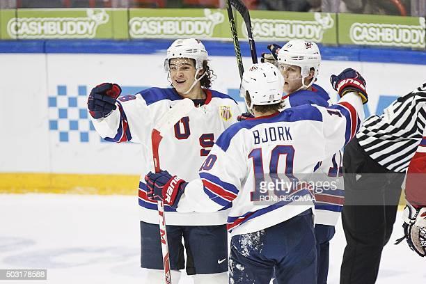 Sonny Milano Anderas Bjork and Christian Dvorak of USA celebrate Dvorak's 20 goal during the 2016 IIHF World Junior Ice Hockey Championship...