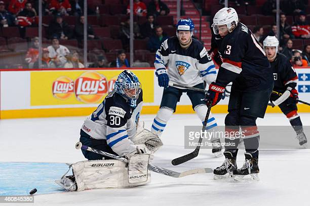 Sonny Milano of Team United States is stopped by Ville Husso of Team Finland during the 2015 IIHF World Junior Hockey Championship game at the Bell...