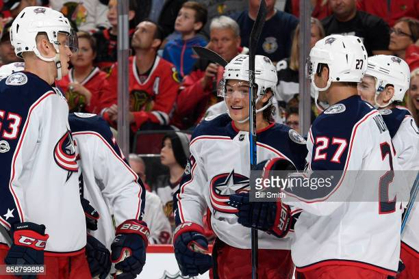 Sonny Milano of the Columbus Blue Jackets celebrates with teammates after scoring against the Chicago Blackhawks in the second period at the United...