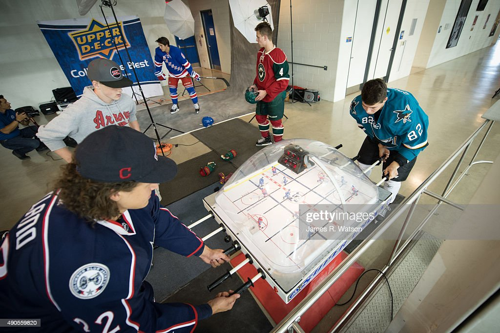 Sonny Milano #22 of the Columbus Blue Jackets competes against Nikolay Goldobin #82 of the San Jose Sharks in a game of table hockey at the 2015 NHLPA Rookie Showcase at Mattamy Athletic Centre on September 1, 2015 in Toronto , Ontario , Canada .