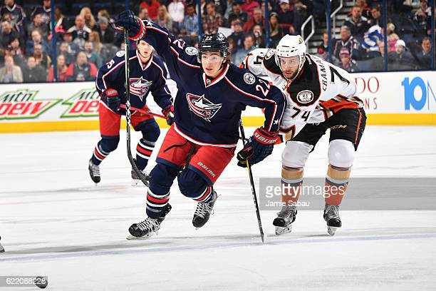 Sonny Milano of the Columbus Blue Jackets skates towards the puck after dumping it past Joseph Cramarossa of the Anaheim Ducks during the first...