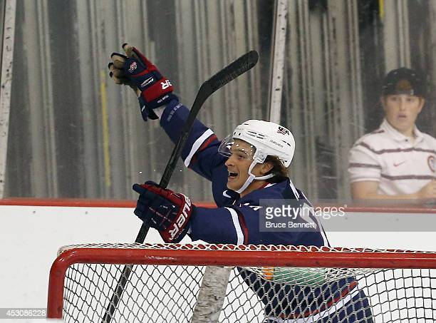 Sonny Milano of USA Blue celebrates his goal against USA White during the 2014 USA Hockey Junior Evaluation Camp at Lake Placid Olympic Center on...