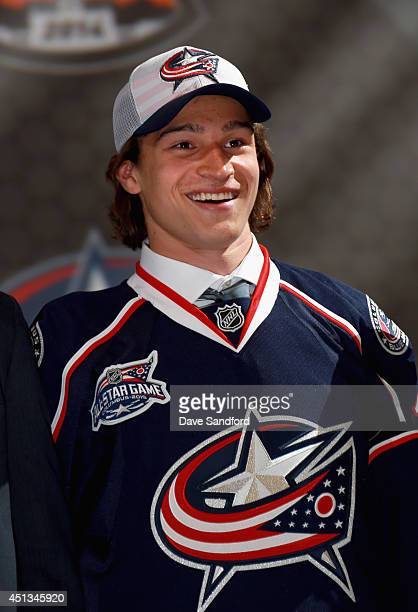 Sonny Milano smiles on stage after being selected 16th overall by the Columbus Blue Jackets during the 2014 NHL Entry Draft at Wells Fargo Center on...