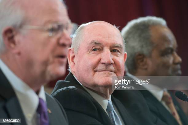 Sonny Perdue nominee for Secretary of Agriculture center is introduced by former Sen Saxby Chambliss RGa left and Rep David Scott DGa during Perdue's...