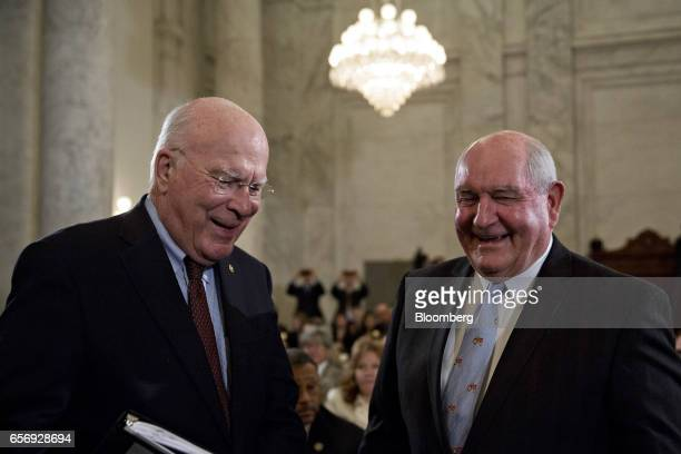 Sonny Perdue US secretary of agriculture nominee for President Donald Trump right shares a laugh with Senator Patrick Leahy a Democrat from Vermont...