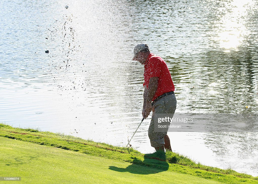 Sonny Skinner of the USA team hits a shot from the water during the Afternoon Foursomes Matches at the 25th PGA Cup at the CordeValle Golf Club on September 16, 2011 in San Martin, California.