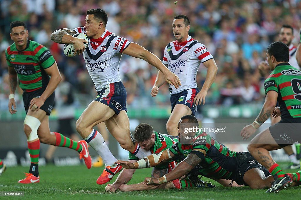 Sonny-Bill Williams of the Roosters makes a break during the round 26 NRL match between the South Sydney Rabbitohs and the Sydney Roosters at ANZ Stadium on September 6, 2013 in Sydney, Australia.