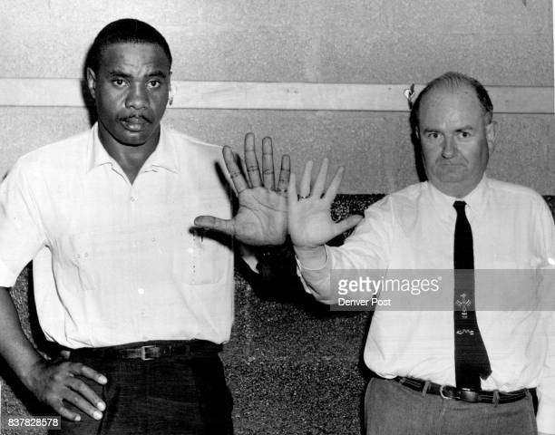 Sonny's Hand Dwarfs that of 'Fighting' Post Reporter The guy on the left with the giant hands is Sonny Liston No 1 heavyweight boxing contender who...