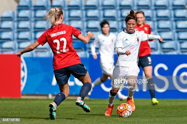 Sonoko Chiba of Japan challengesAnja Sønstevold of Norway during the match between Norway v Japan Women's Algarve Cup on March 6 2017 in Loule...