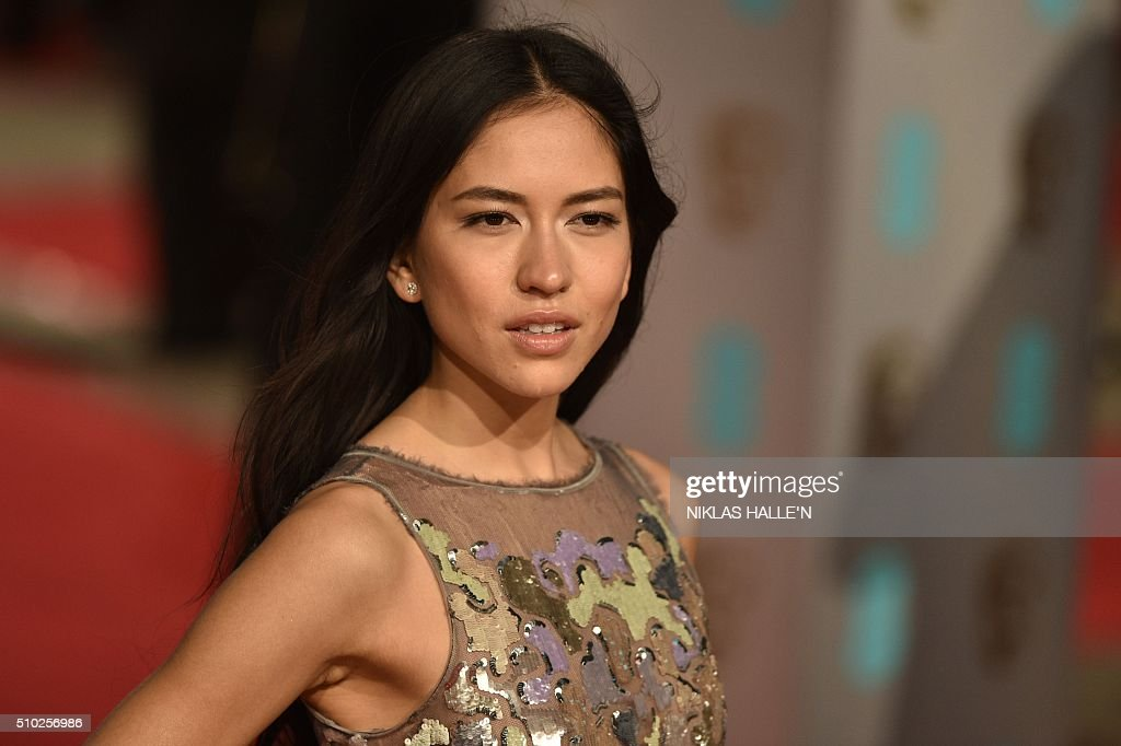 Sonoya Mizuno poses on arrival for the BAFTA British Academy Film Awards at the Royal Opera House in London on February 14, 2016. N