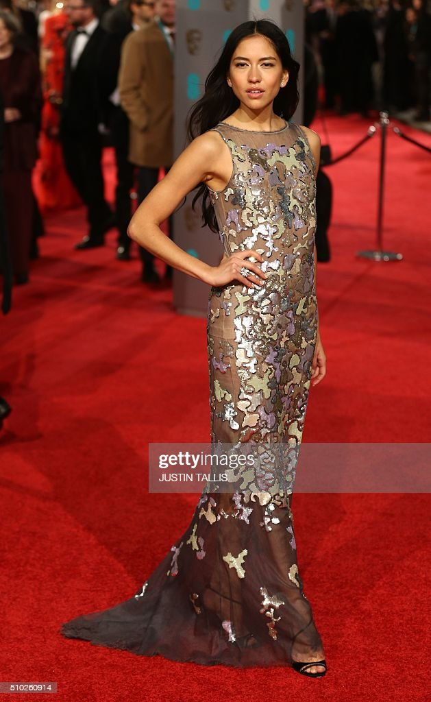 Sonoya Mizuno poses on arrival for the BAFTA British Academy Film Awards at the Royal Opera House in London on February 14, 2016. TALLIS