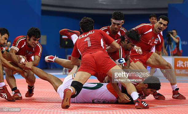 Sonu Narwal of India is captured as he tries to raid for points during the Men's Kabaddi final at Nansha Gymnasium during day fourteen of the 16th...