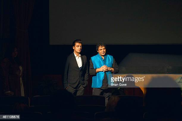 Sonu Nigam and Director Girish Malik talking before the Los Angeles Premiere of 'JAL' at Raleigh Studios on January 6 2015 in Los Angeles California