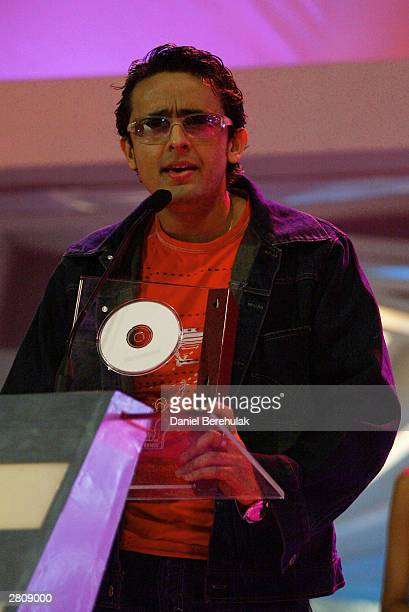 Sonu Nigam receives his award for best singer male during the Inaugural MTV IMMIES at the Goregaon Sports Club December 12 2003 in Mumbai India