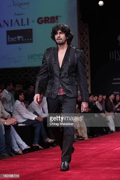 Sonu Nigam walks the runway in a Gitanjali design at the India International Jewellery Week 2012 Day 1 at the Grand Hyatt on on August 19 2012 in...