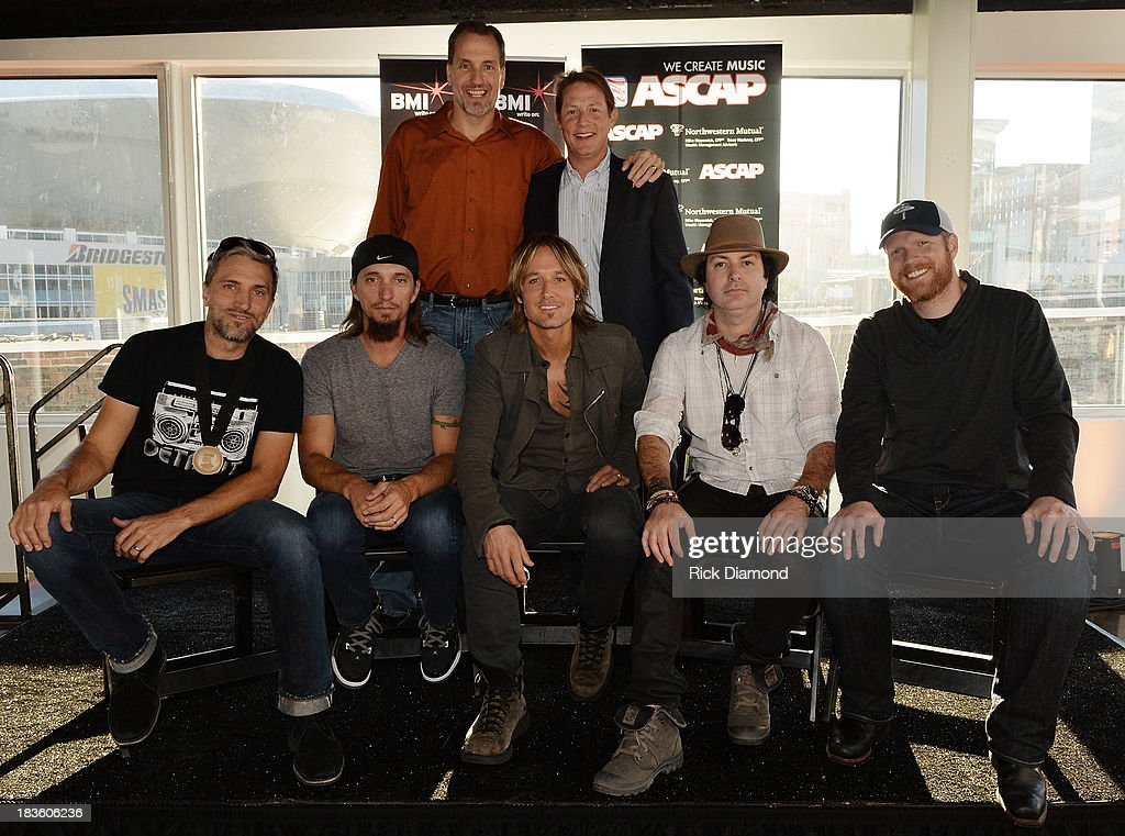 Sony ATV Music Publishing's Tom Luteran, and BMI's Clay Bradley (front row, l-r): co-writers Brett and Brad Warren, KU, co-writer Kevin Rudolf, and producer Nathan Chapman attend as Keith Urban, BMI & ASCAP Celebrate the No. 1 Song 'Little Bit Of Everything' at Aerial In Nashville on October 7, 2013 in Nashville, United States.
