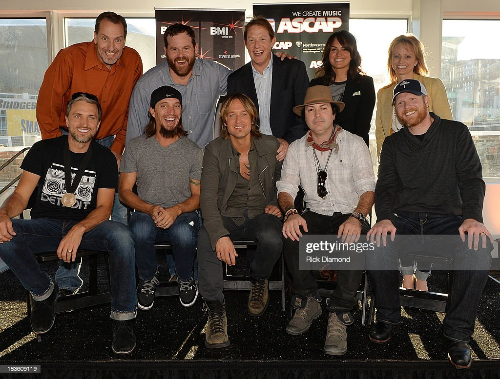 Sony ATV Music Publishing's Tom Luteran, Capitol Nashville's Royce Risser, BMI's Clay Bradley, ASCAP's LeAnn Phelan, ASCAP's Kele Currier (front row, l-r): Co-writers Brett Warren, Brad Warren, Keith Urban, co-writer Kevin Rudolf, and producer Nathan Chapman. pose as Keith Urban, BMI & ASCAP Celebrate the No. 1 Song 'Little Bit Of Everything' at Aerial In Nashville on October 7, 2013 in Nashville, United States.