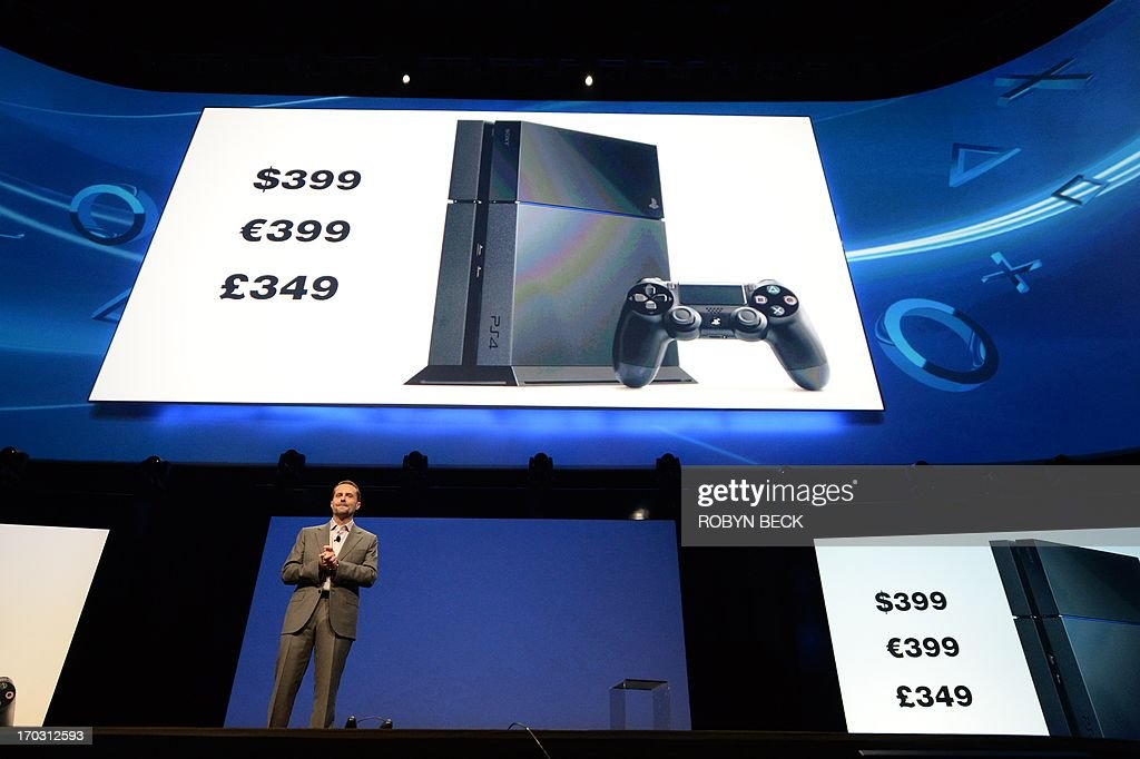 Sony CEO Andrew House announces the pricing for the new PlayStation 4 at the Sony E3 2013 press conference in Los Angeles, California June 10, 2013. House said that the new PlayStation 4 will cost USD $399 and it will be available in time for the 2013 holiday season. AFP PHOTO / ROBYN BECK