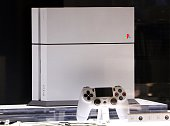 Sony Computer Entertainment's PlayStation 4 20th anniversary edition video game console is displayed at Sony's showroom in Tokyo on December 4 2014...