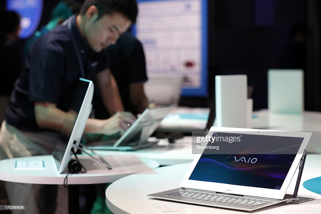 A Sony Corp. Vaio Duo Ultrabook laptop computer, right, is displayed during a product launch in Tokyo, Japan, on Monday, June 10, 2013. Sony Corp. is Japan's biggest consumer-electronics exporter. Photographer: Kiyoshi Ota/Bloomberg via Getty Images