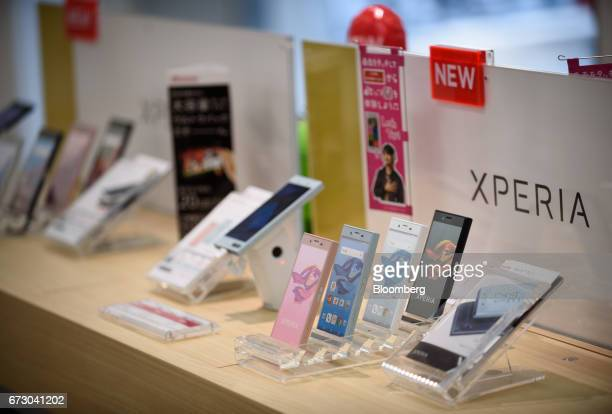 Sony Corp Xperia X Compact smartphones sit on display at an NTT Docomo Inc store in Tokyo Japan on Monday April 24 2017 NTT Docomo one of the world's...