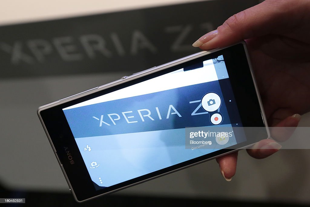 A Sony Corp. Xperia Z1 is held for a photograph by a model after a news conference in Tokyo, Japan, on Friday, Sept. 13, 2013. Sony Corp. is betting its Xperia Z1 handset will propel it to No. 3 in the smartphone market, leaping from seventh place by vaulting past competitors such as LG Electronics Inc. and Lenovo Group Ltd. Photographer: Yuriko Nakao/Bloomberg via Getty Images
