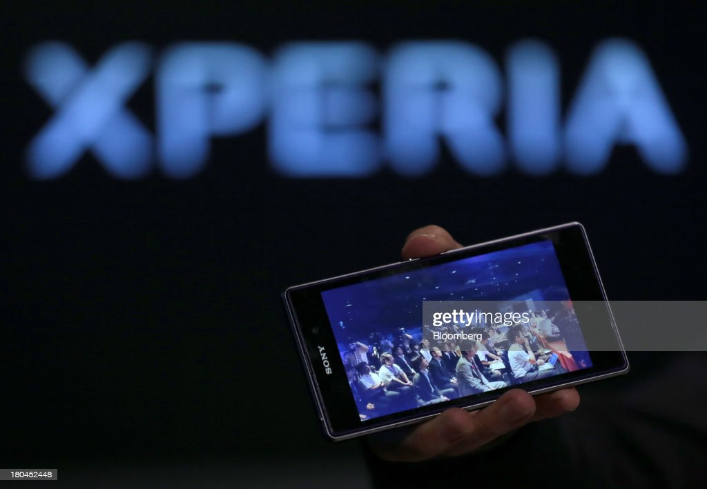 A Sony Corp. Xperia Z1 smartphone with a photo of members of the press is held up during a news conference in Tokyo, Japan, on Friday, Sept. 13, 2013. Sony Corp. is betting its Xperia Z1 handset will propel it to No. 3 in the smartphone market, leaping from seventh place by vaulting past competitors such as LG Electronics Inc. and Lenovo Group Ltd. Photographer: Yuriko Nakao/Bloomberg via Getty Images