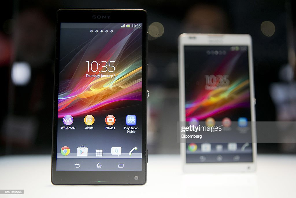 Sony Corp. Xperia ZL smartphones sit on display during the 2013 Consumer Electronics Show in Las Vegas, Nevada, U.S., on Wednesday, Jan. 9, 2013. Sony Corp. is enabling its Bravia TVs, Handycam camcorders and Xperia phones to communicate with each other as Chief Executive Officer Kazuo Hirai tries to end four years of losses. Photographer: Andrew Harrer/Bloomberg via Getty Images