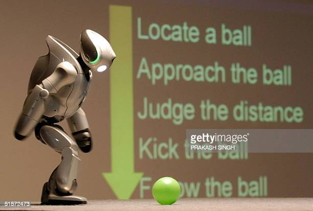 QRIO Sony Corporation's biped entertainment robot prepares to kick a ball during an interaction programme with school children in New Delhi 26...