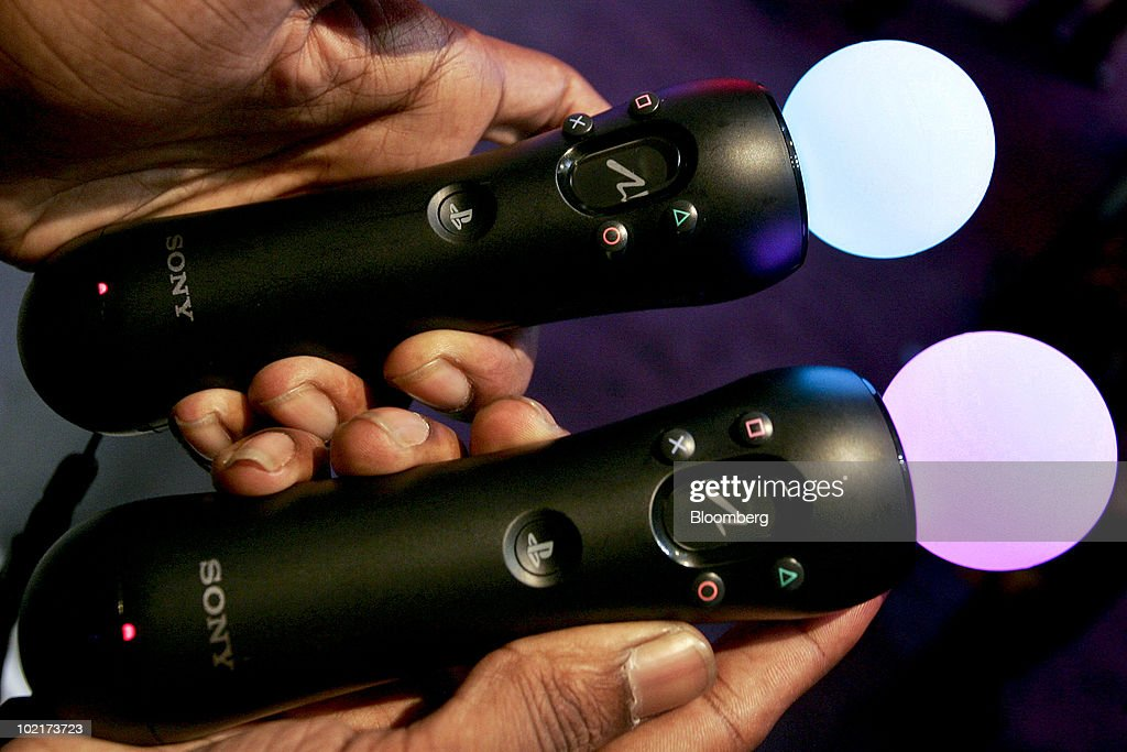 Sony Corp.'s new Move motion controllers for the Playstation 3 console are displayed during the Electronic Entertainment Expo (E3) in Los Angeles, California, U.S., on Wednesday, June 16, 2010. Nintendo Co., Sony Corp., and Microsoft Corp. showed off 3-D and motion sensing capabilities for video games as the companies look to additional features to revive shrinking industry sales. Photographer: Jonathan Alcorn/Bloomberg via Getty Images
