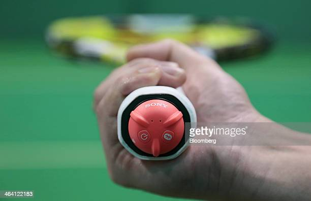 Sony Corp's Smart Tennis Sensor device attached to the end of a tennis racket is arranged for a photograph in Tokyo Japan on Monday Jan 20 2014 The...