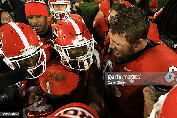 Sony Michel of the Georgia Bulldogs celebrates with teammates after beating the Georgia Southern Eagles in overtime at Sanford Stadium on November 21...