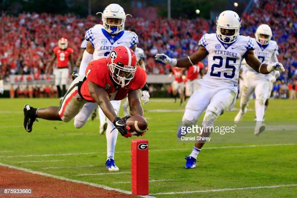 Sony Michel of the Georgia Bulldogs dives into the end zone for a touchdown during the first half against the Kentucky Wildcats at Sanford Stadium on...