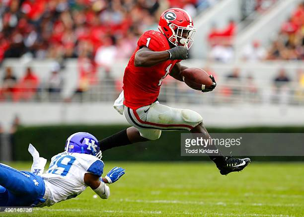 Sony Michel of the Georgia Bulldogs leaps over Derrick Baity of the Kentucky Wildcats in the fourth quarter of the game on November 7 2015 at Sanford...