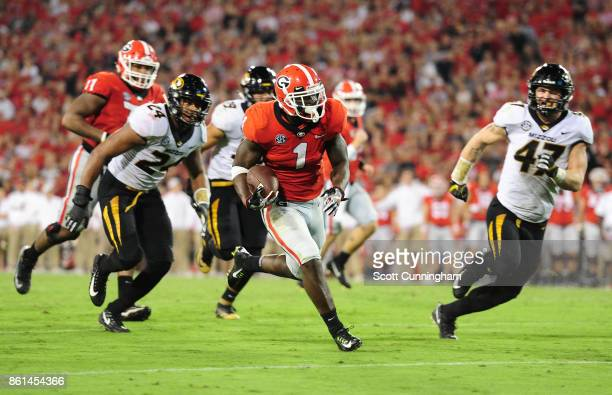 Sony Michel of the Georgia Bulldogs runs for a 2nd half touchdown against the Missouri Tigers at Sanford Stadium on October 14 2017 in Athens Georgia