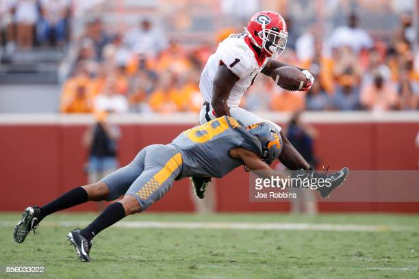 Sony Michel of the Georgia Bulldogs runs the ball against Nigel Warrior of the Tennessee Volunteers in the third quarter of a game at Neyland Stadium...