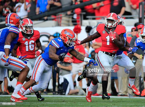 Sony Michel of the Georgia Bulldogs rushes for yardage during the game against the Florida Gators at EverBank Field on October 31 2015 in...